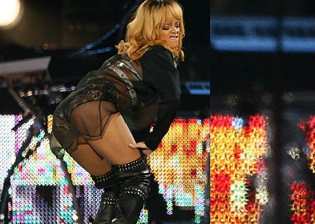 Rihanna Hits Fan With Mic